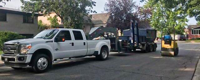 Picture of Quartz Construction Inc. work vehicles.